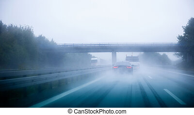 Highway traffic on a rainy day on German European autobahn...