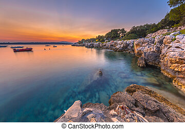Colorful sunset over the rocky coast of Croatia. Long...
