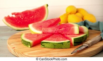 Watermelon slices on wooden vintage background