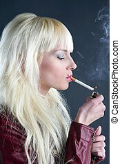 blonde smoking cigarette young fashion girl gray background