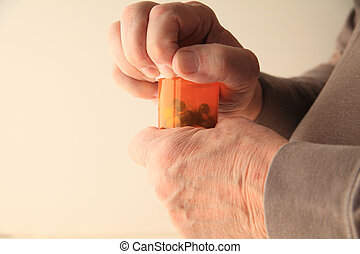 Older man cannot open pill bottle