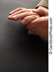 Hand pain with text space - A man grips his aching hand on a...