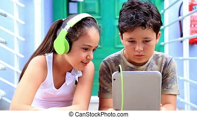 Young boy and girl with digital tablet - Close up portrait...