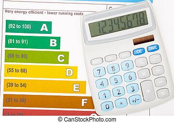 Calculator over colorful energy efficiency chart - studio...