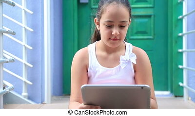Young girl with digital tablet - Caucasian young cute girl...
