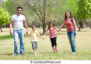 Family posing to camera in the park,outdoor