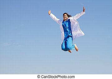 young resident jumping high in sky in scrubs