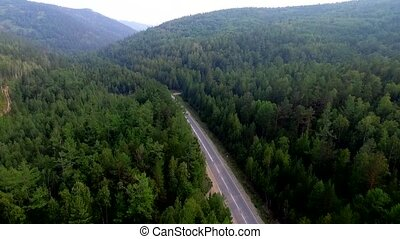 Aerial View Road in the coniferous forest on Lake Baikal,...