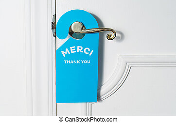 Blue door hanger on white door expressing thank you and...