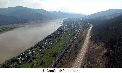 Aerial view of the road through autumn forest Republic Buryatia