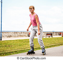 Active young woman rollerskating outdoor - Active young...