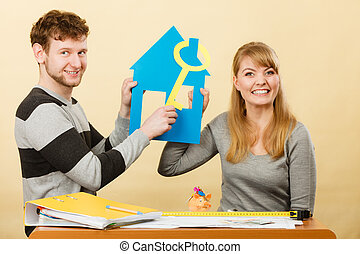 Happy couple dreaming about house. - Dream and new plan for...