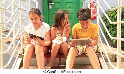 Kids with digital tablet - Portrait of a caucasian three...