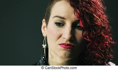 Portrait of red curly hair woman with bright make up, red...
