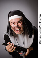 Funny man wearing nun clothing