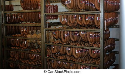 Ready-made sausages hanging in the store freezer