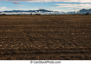 ploughed field in autumn - wide angle view of ploughed field...