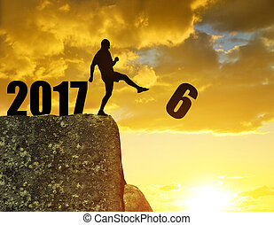 Concept New Year 2017 - Silhouette of man kicked to six....