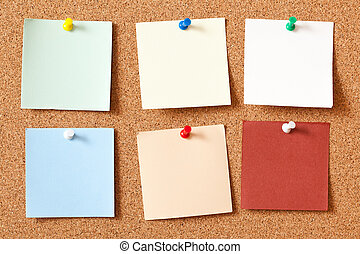 note papers on corkboard