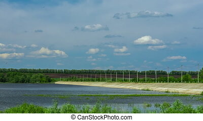dam on the lake reservoir nature bird water period of time clouds sky landscape trees
