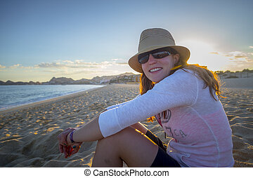 Woman Enjoys time on the beach in Mexico
