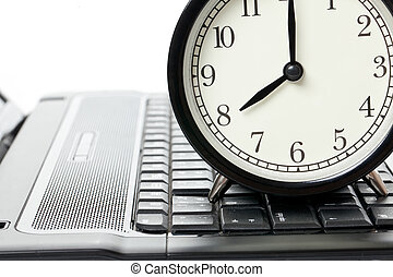 alarm clock and laptop on white background