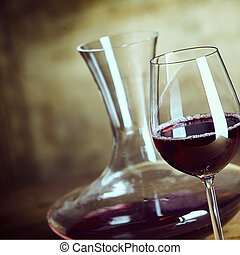 Glass of red wine with a stylish decanter