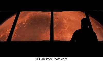 Astronaut Looks At Mars From Space - Man goes to window of...