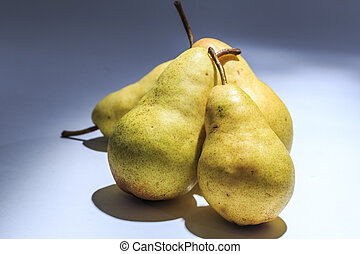 Fresh Picked Pears on bright background