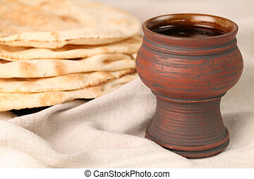 Communion - Chalice with red wine and pita bread