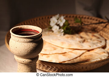 Holy communion - Chalice with red wine and pita bread in a...