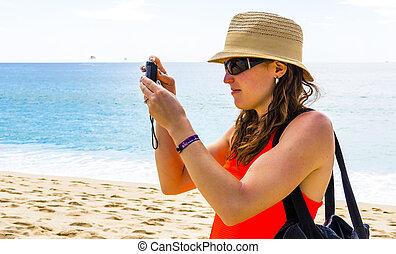 Tourist Woman Sightseeing at Beach on vacation