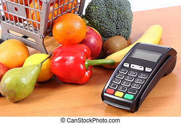Payment terminal with fruits and vegetables, cashless paying...