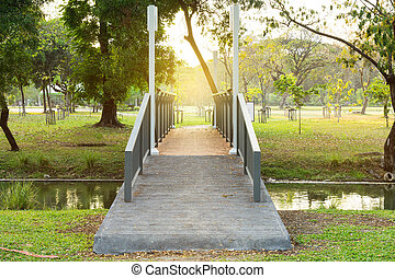 sunlight and bridge in park for cross water