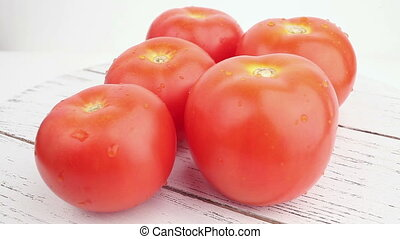 Tomatoes on white background in rotation.