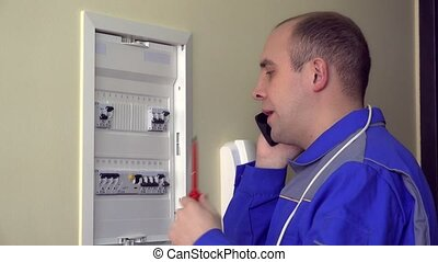 Stressed amateur electrician guy consulting with colleague...