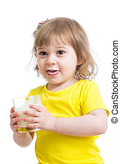Adorable child drinking milk with milk mustache holding...