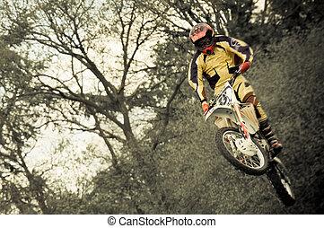 motocross - motion blur motocross dirtbike rider in mid-air