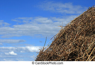 Straw stack sky background - Stack of hay and a blue sky...