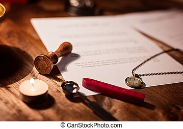 Notary public wax stamper and testament on desk