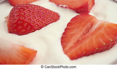 Strawberries in cream - The ripe, juicy strawberries rotate