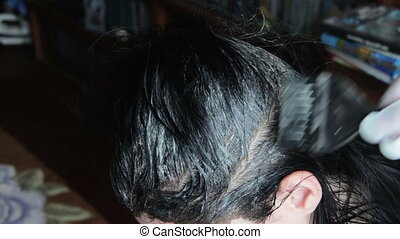 Coloring Dark Hair by a Hairdresser - Hair Coloring Girl in...