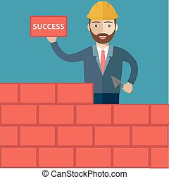 Successful businessman in yellow hard hat with trowel and bricks building a new business, for start-up theme design