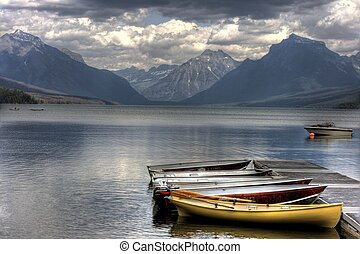 Docked Canoes - Serene scene on Lake McDonald, Glacier...