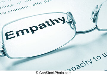 Empathy sign on a paper and glasses.