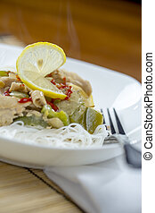 Closeup view of a bowl of thai green curry and rice...
