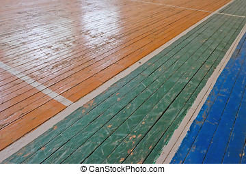 old markings in the gym - Wooden floor of sports hall with...