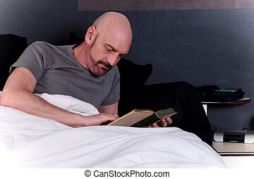 Bald middle aged man book