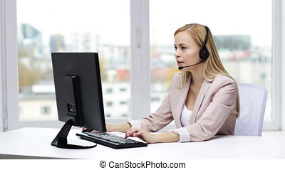businesswoman with computer and headset talking - business,...
