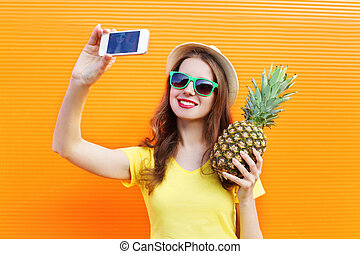Fashion pretty cool girl in sunglasses, hat with pineapple...